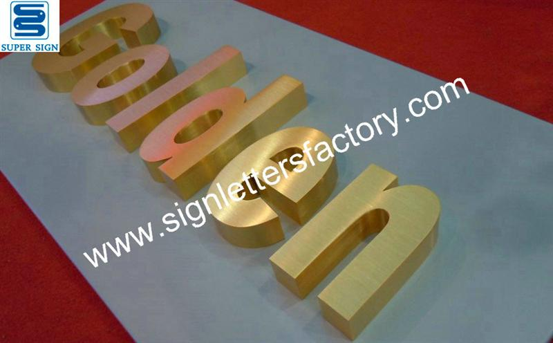 golden brushed stainless steel sign letters